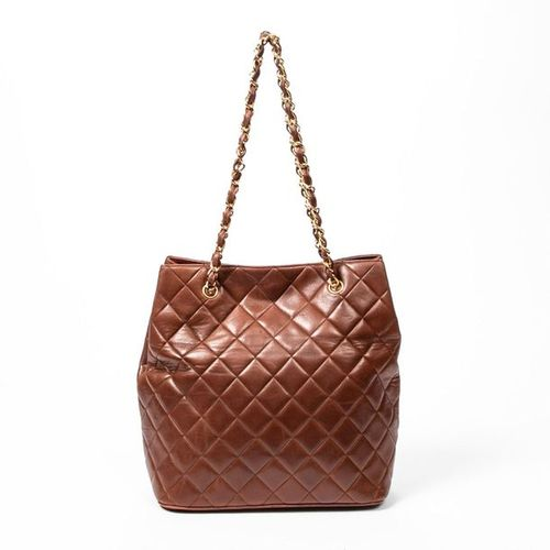 CHANEL Pre Loved Chanel CC Turnlock Tall Tote in Brown Quilted Leather. Gold har…
