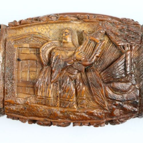 Snuffbox in carved corozo nut with characters, flowers and fruits.  19th century…