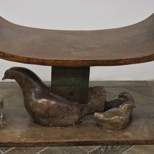 Wooden curule stool, partially polychrome, showing a hen and her chicks at the b…