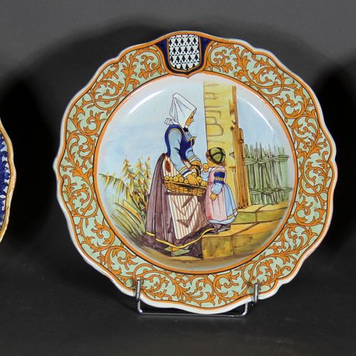 Set of three round poly lobed earthenware plates decorated with Breton scenes.  …