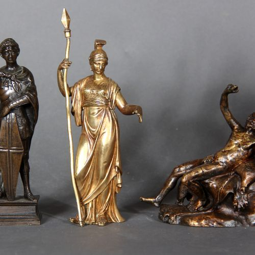 Lot of six sculptures in patinated metal decorated with characters.  H of the bi…