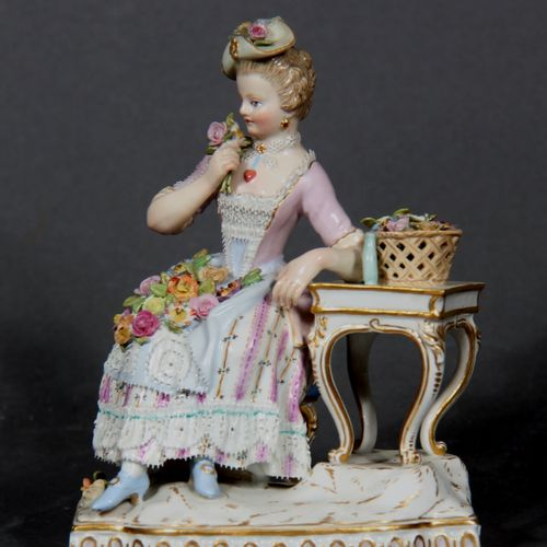 MEISSEN  Young girl with roses.  Group in polychrome and gilded porcelain, marke…