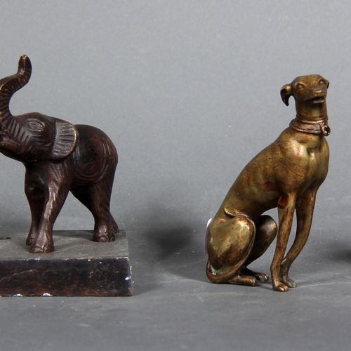 Metal and bronze lot representing two greyhounds, a lion and an elephant.  H of …