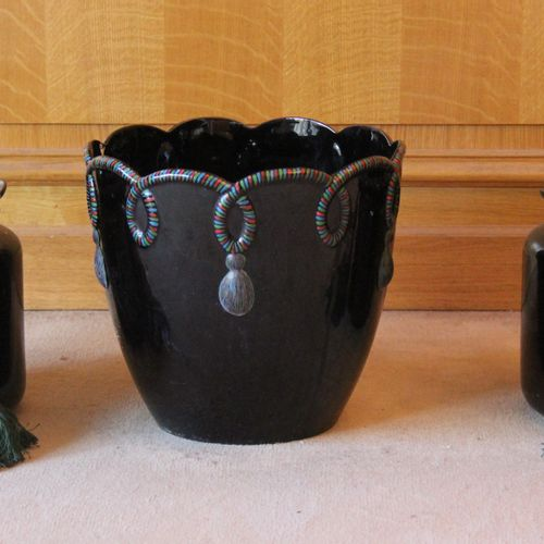 Lot :   A pair of black glazed ceramic flared neck vases with green cloth tiebac…