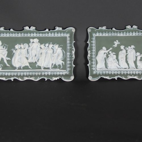 Six rectangular and oval bas reliefs in white biscuit on a green background deco…
