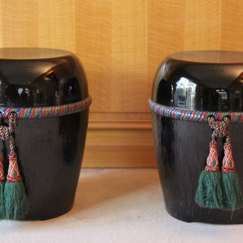 Pair of black glazed ceramic drum stools with polychrome cord frieze  H : 52 D :…