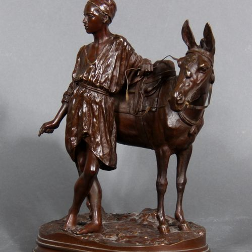 Alfred DUBUCAND (1828 1894) after  The donkeyman of Cair.  Bronze sculpture with…