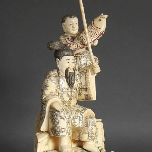 Bone veneer sculpture representing a fisherman and his son, Japanese style.  H :…