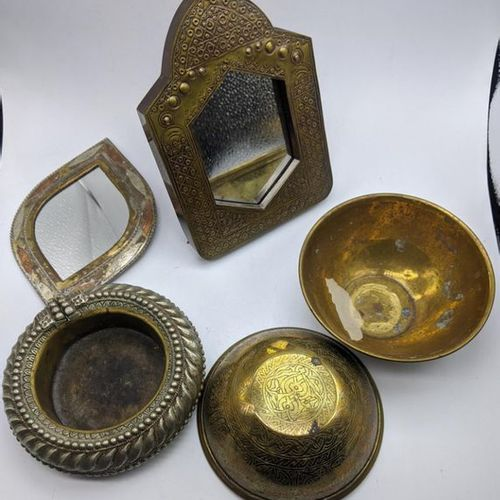 A collection of Middle Eastern items to include mirrors, bowls and an anklet dis…