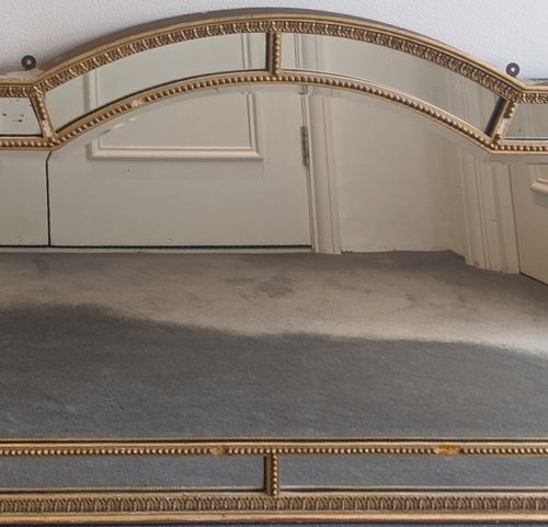 A gilt framed panelled mirror