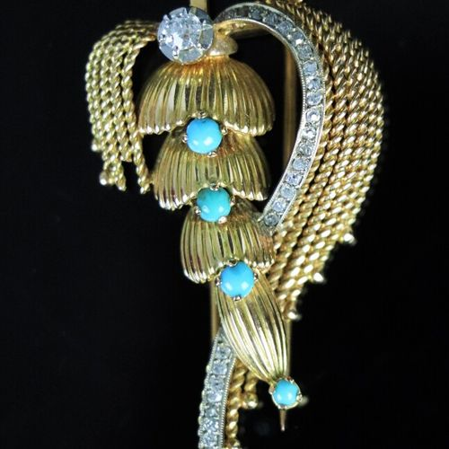 Yellow gold brooch with a finial, decorated with turquoise cabochons and diamond…