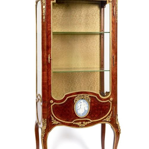 Straight veneer paneled display case opening through a leaf with bevelled glass …