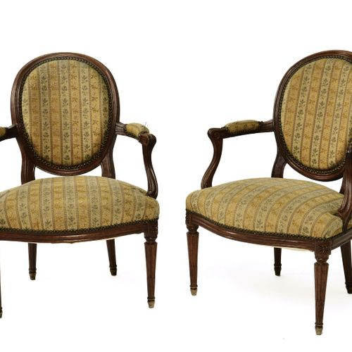 Pair of armchairs with cabriolet backrest medallion molded and carved wood.  The…