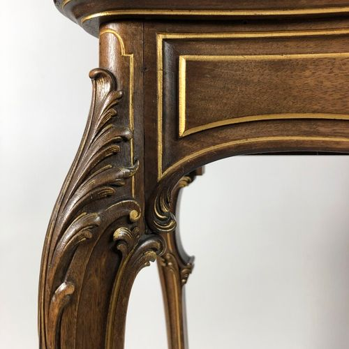 Moulded, carved and gilded wooden display case, the pediment in rocaille shell. …