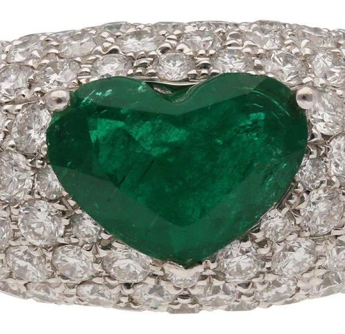 Emerald Brilliant Ring  Cocktail ring in white gold 18K.  In the centre an emera…
