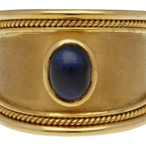 Sapphire Gold Ring  Solid designer piece in yellow gold 18K.  In the center a sa…