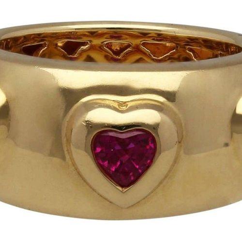 Burma Ruby Ring  Modern design in yellow gold 18K.  Set in heart shape 3 Burmese…