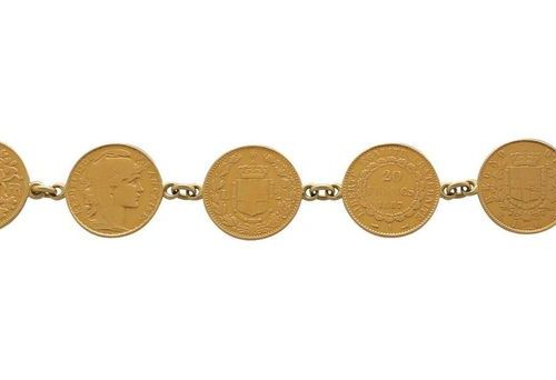 Coin bracelet  Very decorative bracelet in yellow gold 18K.  The jewelry consist…