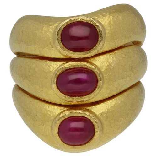 Ruby ring  Extravagant design in yellow gold 22K.  Powerful ring with 3 ruby cab…