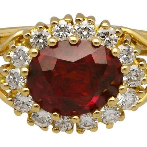 Ruby Diamond Ring  Timeless design in yellow gold 18K.  In the center a ruby of …