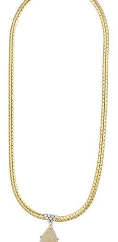 Opal diamond necklace  New designer piece in yellow gold 18K.  As an eye catcher…