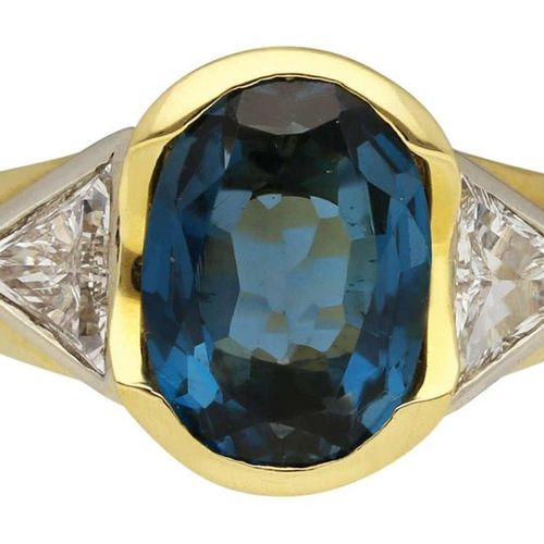 Topaz Diamond Ring  Decorative design in yellow gold 18K.  As an eye catcher an …