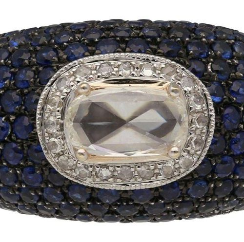 Sapphire Diamond Ring  Fine, opulent handmade in 18K white gold.  On the front s…