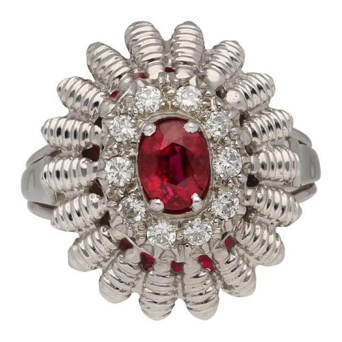 Ruby Diamond Ring  Imposing piece of jewellery in white gold 14K.  In the center…