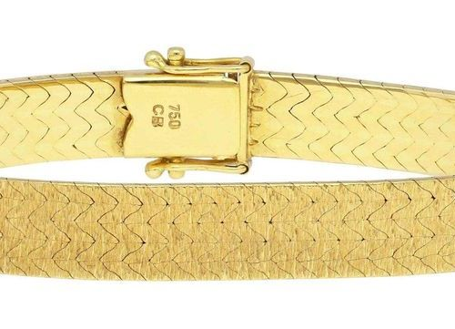 Gold bracelet  Elegant design by C. Bucherer, Zurich, in 18K yellow gold.  Front…