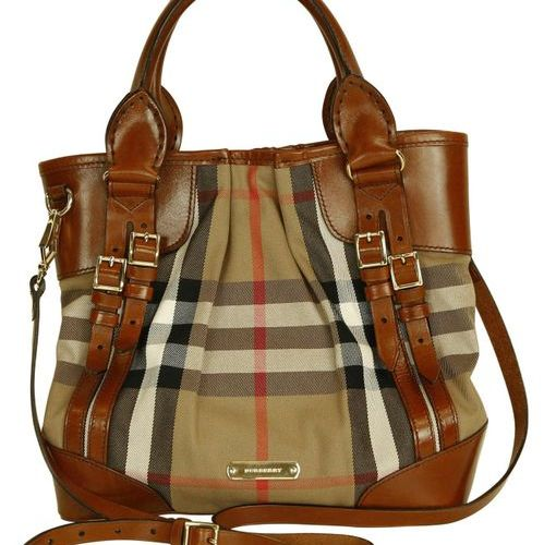 BURBERRY Handbag  Attractive handbag with shoulder strap in cognac coloured canv…