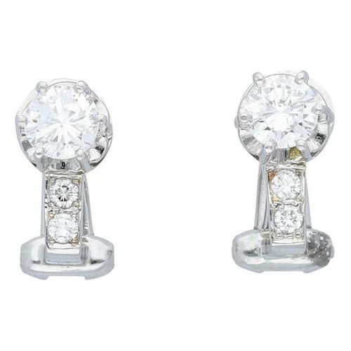 Brilliant earclips  Elegant pair in white gold 18K.  Earclips each with a diamon…