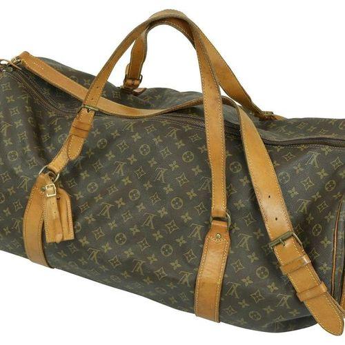 LOUIS VUITTON Keepall 70  Travel bag in brown monogram canvas.  Width 70 cm, hei…