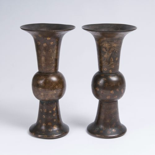A Pair of Gold Splash Gu Vases. China, Qing Dynasty, 18th/19th cent. Bronze with…
