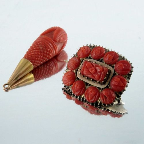 A 19th century gold and carved coral brooch, together with a carved drop pendant…