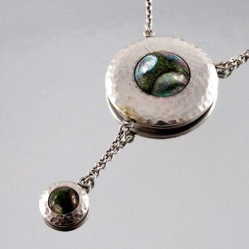 A Secessionist style silver and enamelled necklace, the circular pendant, planis…