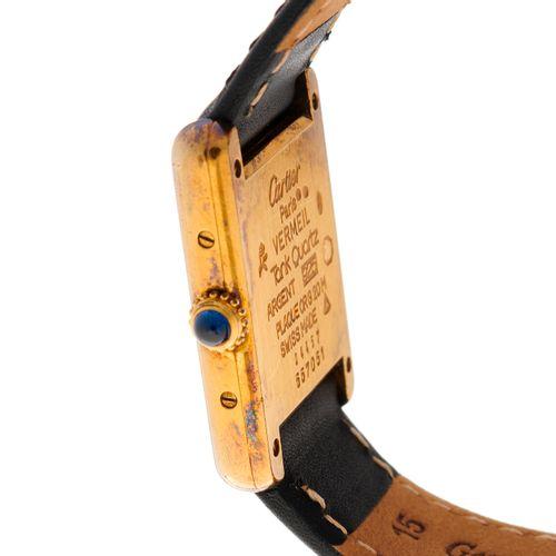 Cartier, une montre bracelet must de Cartier Tank en argent et plaqué or, cadran…