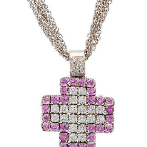 Un saphir rose en or 18ct et un pendentif croix flexible en diamant taille brill…