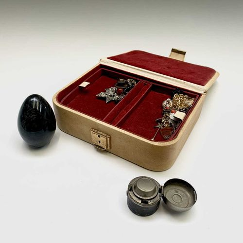 A jewel box and contents including a stone egg