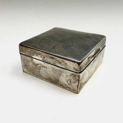 A small plain silver cigarette box, a glass rouge pot with silver lid and a silv…