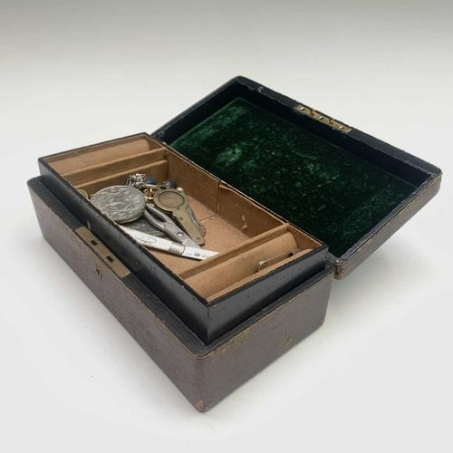 A jewel box and contents including a pair of gold faced silver cuff links, a dia…