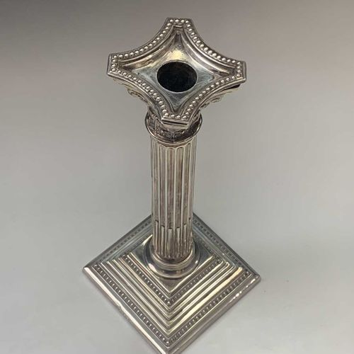 A pair of filled silver classical column candlesticks London 1974 Ht 25.5cm