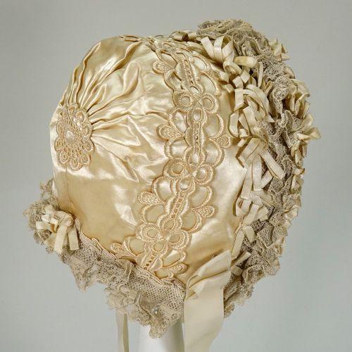 A beautiful ivory silk baby bonnet, late nineteenth century, A beautiful ivory s…