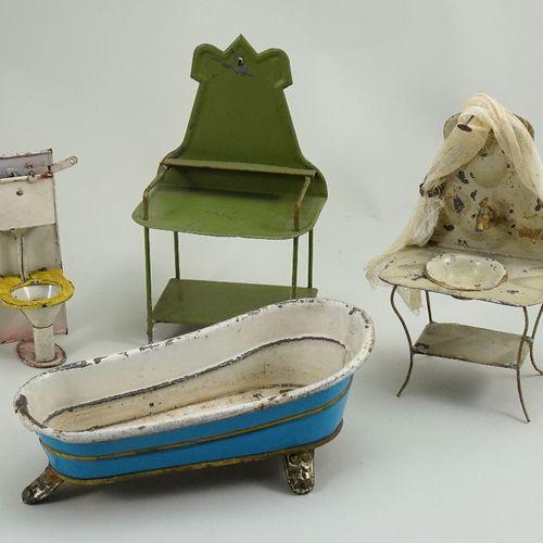 Four pieces of tin plate dolls house furniture, German, circa 1900, Four pieces …