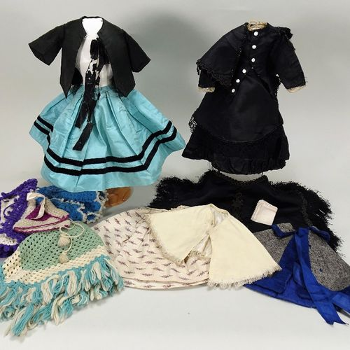 A rare and important E.Barrois bisque shoulder head fashion doll in her original…