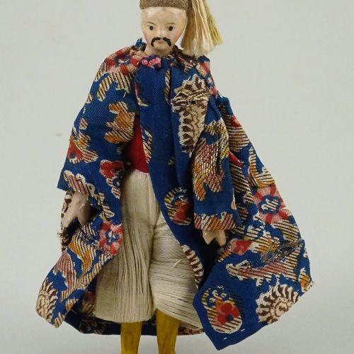 A rare miniature painted wood china man doll, German circa 1830, A rare miniatur…
