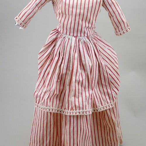An early red and cream striped cotton dolls dress, circa 1860, An early red and …