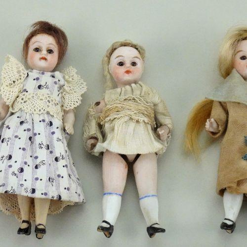 Three miniature all bisque dolls, German circa 1915, Three miniature all bisque …