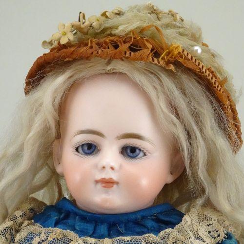 A scarce Simon & Halbig DEP 719 bisque shoulder head doll with swivel neck, Germ…