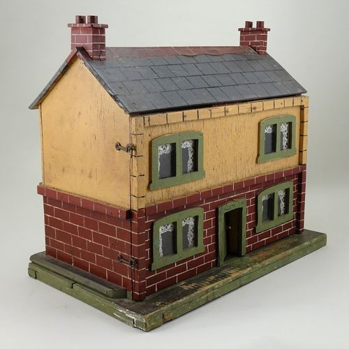 A small painted wooden dolls house, English circa 1920, A small painted wooden d…