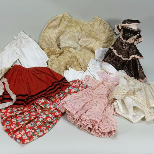 A collection of various dolls clothes, A collection of various dolls clothes, in…